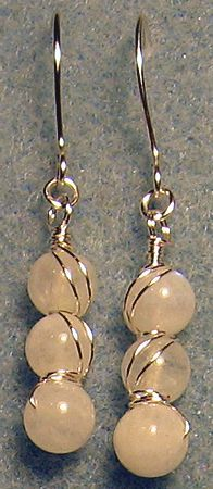 3 moonstone beads all wrapped up & twisted in sterling plated wire w/ handmade ear wires.