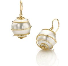 """If you want something just a bit more special than plain studs, these gorgeous """"Orbiting"""" pearls by Mish New York can look equally good with a cocktail dress or t-shirt and jeans."""