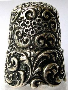 ornate silver thimble  oh to quilt with a thimble like that