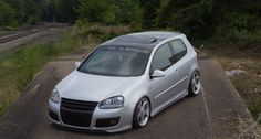 SAVE THE WHEELS windshield banner on a Volkswagen GTI