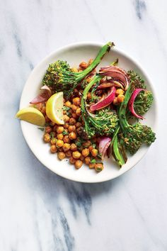 Charred Broccolini and Onion Chickpea Bowls | Eating more plant-based meals is easier to do when they're as tasty and quick to prepare as this one. Much of the deliciousness comes from charring the Broccolini and the onion wedges in a superhot cast-iron skillet; those deeply browned, crisp edges impart incredible flavor with no additional fat, sodium, or calories. And talk about a weeknight dinner workhorse—canned unsalted chickpeas are fast, convenient, and hearty.