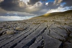 The Burren is a region enclosed by the villages of Ballyvaughan, Kinvara, Tubber, Corofin, Kilfenora and Lisdoonvarna and it includes one of the six national parks in Ireland. The Burren, northwest County Clare, Ireland.