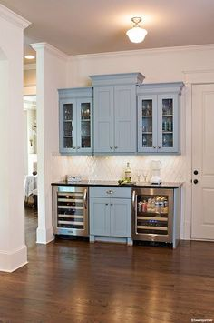 Like the idea of a built-in beverage station with the glasses above & mini-fridge for the kids.