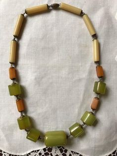 Here is an early Art Deco bakelite necklace with a brass barrel clasp from a Maine estate. It has been tested with Simichrome and tested positive for