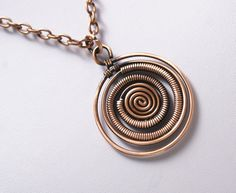 A personal favorite from my Etsy shop https://www.etsy.com/listing/455448872/wire-wrapped-necklace-copper-pendant