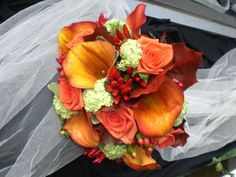 Autumnal massed handtied, with mango calla lily and red chilli peppers! see more at #www.flowerbox-leicester.co.uk #mangocallawedding