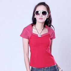 Semi-loose fitted cap sleeved blouse in solid and polka dot red cotton stretch.