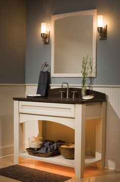 """Designer Bath Cabinetry shown with """"Arcadia"""" door style with Rattan insert in Maple with Antique White/Espresso Glaze finish."""