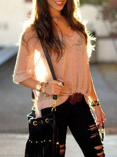 I love the black ripped jeans with the light pink sweater.