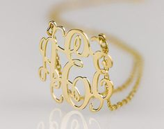 Monogram necklace - 1.25 inch Personalized Monogram - 925 Sterling silver 18k Gold Plated. $47.95, via Etsy.