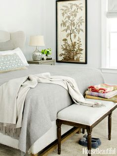 Subtle grays are layered in the master bedroom of a modern country Connecticut house designed by Joan Osofsky and Dana Simpson