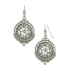 The perfect pair of dangling medallion style earrings are long sought for and rarely found. These beauties are resplendent in shimmering hues of diamond and platinum. The carefully etched design in the center seems to draw you in and each look finds you a new and extravagant design.