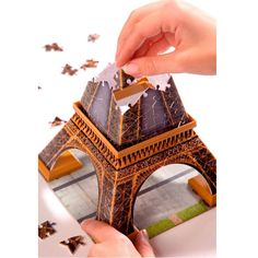 Featuring 216 plastic puzzle pieces and easy click technology, this premium 3D building puzzle from Ravensburger requires no glue to create your own Eiffel Tower model.