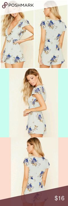 Blue Floral Romper Floral romper size small. It has a front panel that makes it look like a dress at first glance. V-neck plunge cut. Looks great with wedges. No damage except slight discloration around armpit area. (pic #5). Reasonable offers are welcomed. f21 Pants Jumpsuits & Rompers