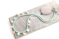 Sea Shells Sunglasses Holder for Women, Mint Boho Sunglasses Necklace, Cowrie Shells Glasses Strap for Her, Pocoloco Eyewear Accessories Boho Mint Sea Shells Sunglasses Holder for Women. Diy Fashion Accessories, Sunglasses Holder, Sea Shells, Beaded Bracelets, Chain, Mint Necklace, Seashell Jewelry, Wooden Beads, Lenses