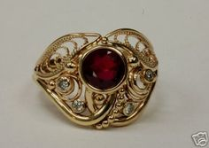 14 K Gold Ruby and diamonds ring. Handmade