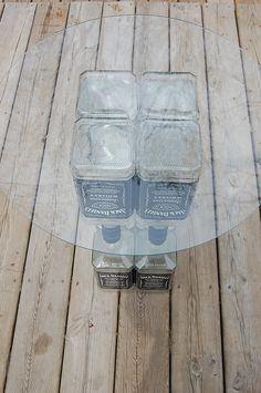 Jack Daniels Glass Top Table-Liquor Bottle-Recycled Bottles-Lounge-Bar-Man Cave-Cabin-Hunting Camp. $85.00, via Etsy.