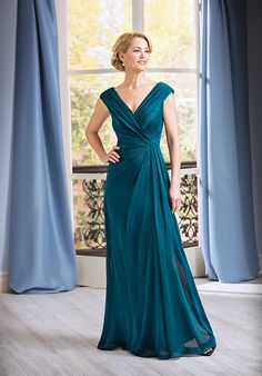 A Jasmine favorite, this mother of the bride dress features a beautiful portrait neckline, pleated details to give perfect shape and simple a-line skirt creating a very regal style for any mother of the bride or groom!