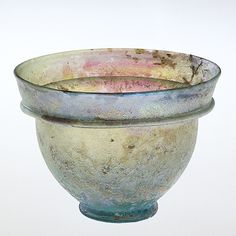 A patella cup, first-century A.D., Roman drinking cup, blown, tooled.