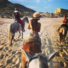 Naya Rivera Rides a Horse in Cabo on July 19, 2014 with husband Ryan Dorsey