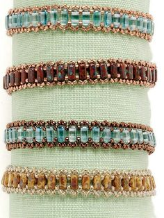 Peyote-stitched embellishments decorate two-hole bricks and cylinder beads in an easy-to-wear pattern. Build your beading skills with flat peyote stitch to form picot-like edging.  Finished Size:  7¾