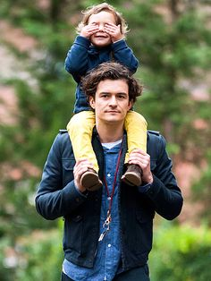 PEEK-A-BLOOM Orlando Bloom goofs around with son Flynn, 2½, at a park in New York on  December 6, 2013 .