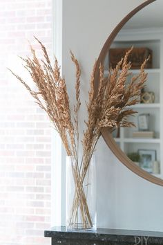 How to add small touches of fall decor throughout your home, without spending too much time or money. We love these easy seasonal ideas to add in a bit of fall to your house. Put wheat into a tall vase instead of flowers to make a small fall change in yo Hallway Inspiration, Decoration Inspiration, Hallway Ideas, Clear Vases, Tall Vases, Instead Of Flowers, Diy Playbook, Deco Addict, Contemporary Home Decor
