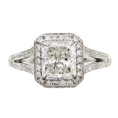 5d0ce21f7 0.91CT RADIANT CUT DIAMOND ENGAGEMENT RING A 0.91CT radiant cut diamond is  featured in