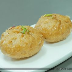 Mawa stuffed Balushai makes an amazing sweet recipe to enjoy with friends and family.  Recipe in English - https://goo.gl/37KWFj (copy and paste link into browser)  Recipe in Hindi - https://goo.gl/QVQ5Sh (copy and paste link into browser)