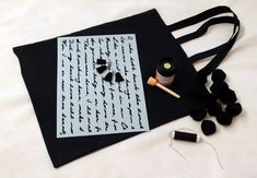 Black tote painted with Script stencil and decorated with tassels. Stencil Art, Stencils, Black Tote, Script, Shopping Bag, Tassels, Textiles, How To Make, Diy
