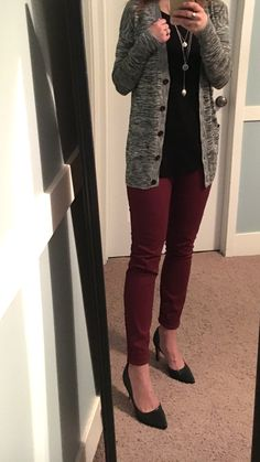 Black and white cardigan, black top, maroon skinny pants, black heels