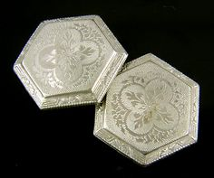 Beautifully engraved platinum top cufflinks decorated with foliate and quatrefoil designs.  The six-sided shape is accented with striking Art Deco borders.  Crafted in platinum and 14kt gold,  circa 1920.