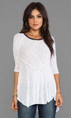 White flow-y t-shirt.