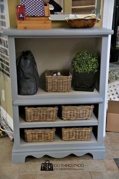Finished dresser/console with section holding purse and levels holding wicker baskets
