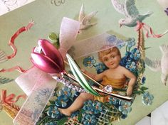 Vintage Tulip Flower Brooch  - Excellent Vintage Condition  -Pink Tulip with Gold Tone and Rhinestone Accent  -Antique Postcard is Embossed  - A Unique Valentines Gift  The postcard is over 100 years old and and shows its delicate age with some wear around the edges and corners. The back has the original note from the sender discussing the times and days of a century ago. The card still has the original one cent stamp and is dated 1914. This is a charming piece of the past.  **Bow and pin…