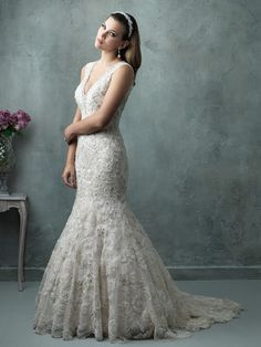 C326  A glimmer of crystal beading is infused into this V-neck mermaid gown, which features a gorgeous open back.  Fabric: Lace Size: 2 - 32 Colors: White/Silver, Ivory/Silver/Gold, Champagne/Ivory/Gold/Silver