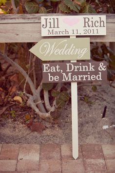 Direction signs for outdoor wedding