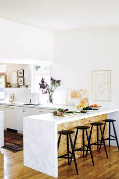A shade of white that doesn't feel too cool. Love how it picks up the honey tones in the floor.