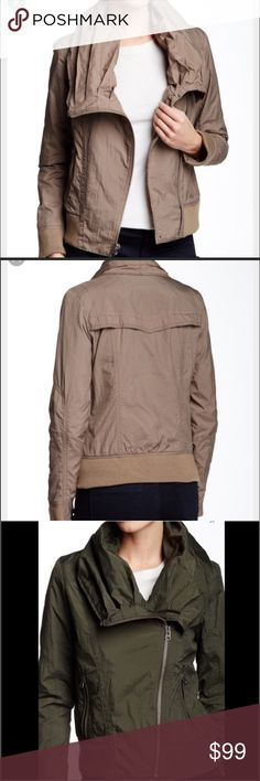"""7 for all mankind Nylon Bomber Jacket in Beige 7 for all mankind Nylon Bomber Jacket in Beige A pleated funnel neck adds shape to a nylon, asymmetric zip bomber jacket. - Funnel neck - Long sleeves  - 2 front zip pockets - Ribbed trim - Approx. 22.5"""" length - Imported Fiber Content Shell: 100% nylon Lining: 100% polyester 7 For All Mankind Jackets & Coats"""