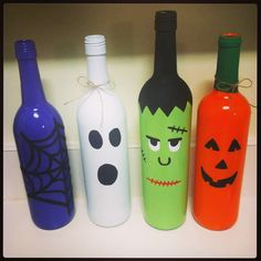 Spray painted Halloween wine bottles
