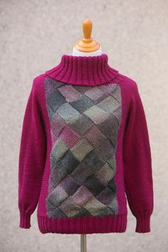 Grandmas Favorite Sweater - This lovely sweater begins with an entrelac piece in the middle front, knit from variegated yarn. With a matching back piece and a cowl neck for added comfort and warmth, this sweater is a great addition to your winter wardrobe. From the February 2015 issue of I Like Knitting