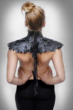 ANNE HOLM, leather feathers