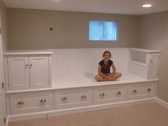 Large Storage Bench - Bed. Love this idea in a small room. More floor space.  The cabinets on the left could go all the way to the ceiling for more storage.  Great for growing girl in a tiny room.