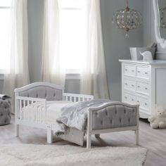 Orbelle Upholstered Toddler Bed - Gray/French White - Every dream will be sweet when she's tucked into the Orbelle Upholstered Toddler Bed - Gray/French White. With a solid wood frame in a French whit...