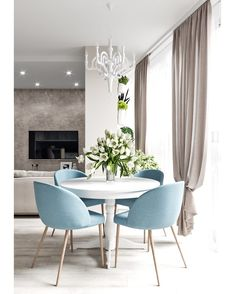 Modern Dining Table Best Tips on a Modern Dining Table Modern Dining Table. A modern dining table is quite different from the traditional ones with respect to various features. The design is one of… Dinner Room, Modern Dining Table, Round Table With Chairs, Coloured Dining Chairs, Small Chairs, Blue Chairs, Kitchen Dining, Dining Room Inspiration, Life Inspiration