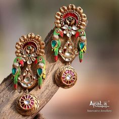 The Exotic Parrot Earrings from Apala by Sumit would leave you spellbound! Look exuberant in this Vibrant Indian colour palette! Indian Jewelry Earrings, Jewelry Design Earrings, Gold Earrings Designs, Gold Jewellery Design, Enamel Jewelry, Crystal Jewelry, Bridal Jewelry, Gold Jewelry, Jewellery Diy