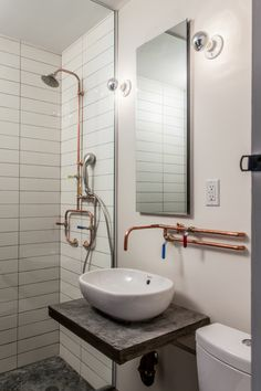 This innovative Brooklyn apartment renovation features funky but sensible repurposed materials while fully optimizing the unit& 675 square feet. Copper Bathroom, Bathroom Plumbing, Basement Bathroom, Industrial Bathroom Design, Plumbing Pipe, Bathroom Colors, Bathroom Sets, Small Bathroom, Brooklyn Apartment