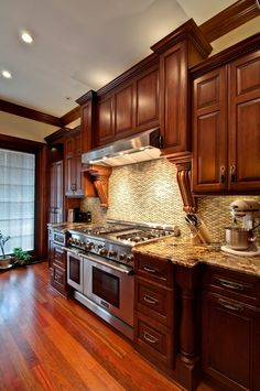 Traditional Cherry Kitchen... I don't usually like Cherry wood, but the woodwork is beautiful