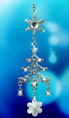 "Christmas Tree Holiday Ornament with Crystals by Banberry Designs. $8.99. Victorian Flair Christmas Tree with Snowflake Jeweled Christmas Ornament. Shining silver metal ornament embellished with sparkling crystals and a hanging snowflake. Display on a stand or hang on your Christmas tree. Measures 5""H x 1.5""W"