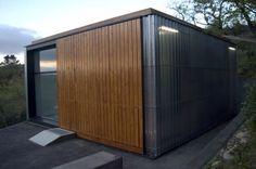 Corrugated Plastic and Cork Cabin Exterior